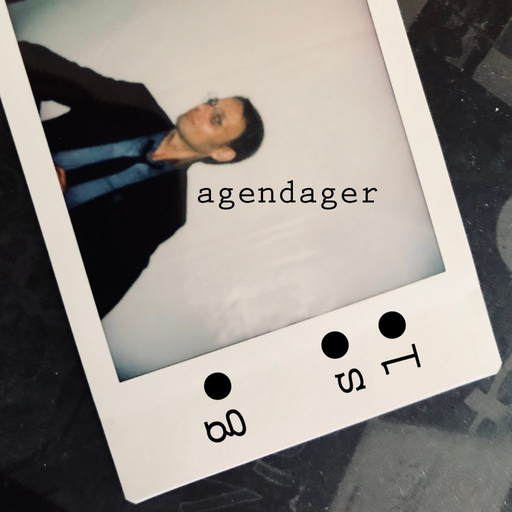 coverartwork for go solo agendager depicting the songwriter on a blurry polaroid